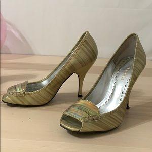 BCBGIRLS Iridescent cream colored peep toe heels